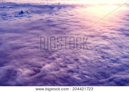 Amazing cloudscape at sunset time. View from the airplane window.