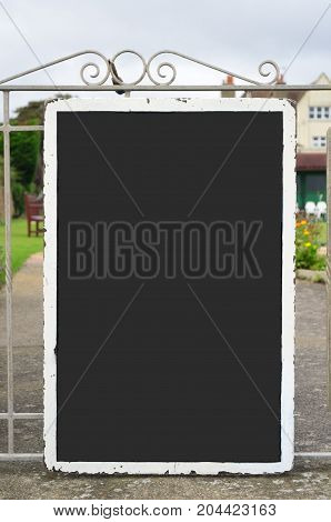 Grey Blank Chalkboard With White Aged Surround Located Outdoors