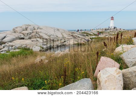 Rocky coastline and lighthouse Peggy's Cove Nova Scotia Canada