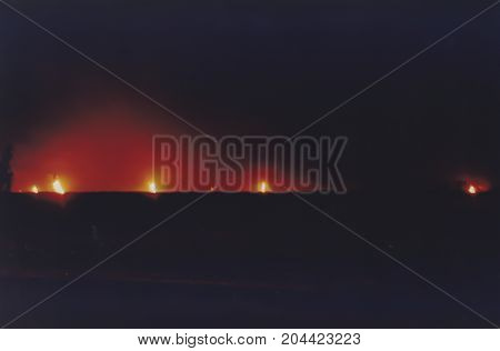 Massive Oil Well Fires On Horizon  In Field With Of Kuwait