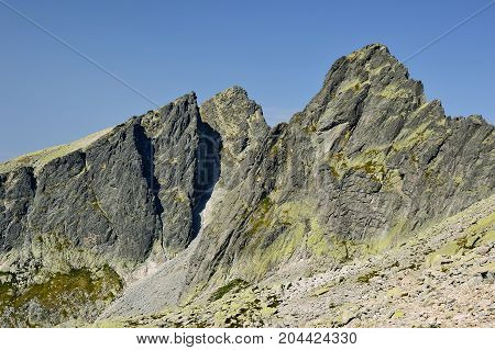 High Tatras in Slovakia. Monumental peaks. Summer scenic landscape mountain view. Alpine trail. Javorovy and Ostry peak in Big cold valley.