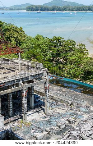 Ruins Of An Old Abandoned Hotel Destroyed By Marauders. Phuket Island, Thailand