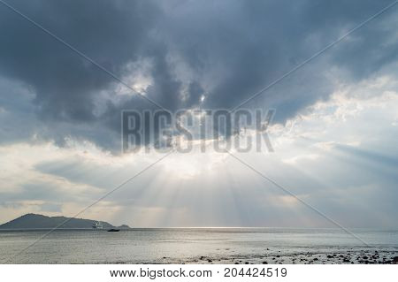 Rays Of Light Shining Through Dark Clouds. Dramatic Sky With Cloud