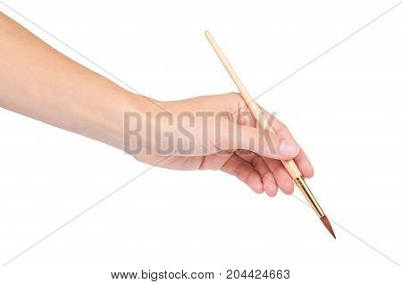 Paint Brush In Hand Isolated On White Background