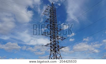 Electrical transmission tower on sky background at sunset.
