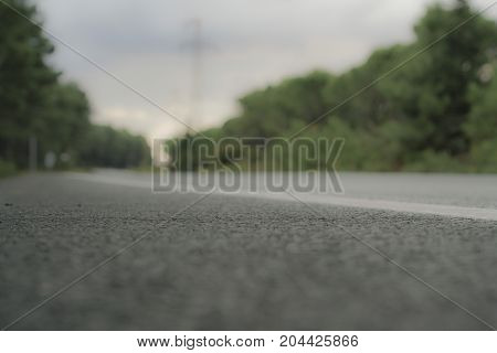Blurred Background With An Empty Asphalt Road