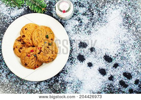 Milk and cookies prepared for Santa Claus and Santa's footsteps
