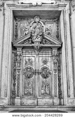 Carved wooden portal of an italian church.
