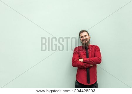 Young Adult Success Businessman Crossed Hands And Looking At Camera And Toothy Smile.