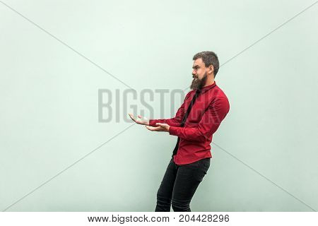 Bearded Man In Casual Clothes, Keeps Something Heavy