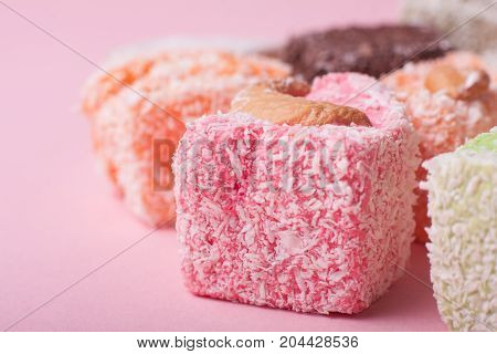 Eastern various colorful sweets on pink background