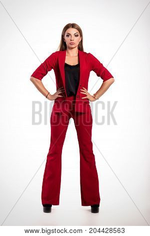 Beautiful Successful Businesswoman, Girl Or Woman In Business Red Suit Standing On Isolated White Ba