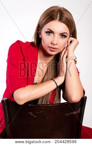 Beautiful Successful Businesswoman, Girl Or Woman In A Business Red Suit, Sits On A Chair On An Isol