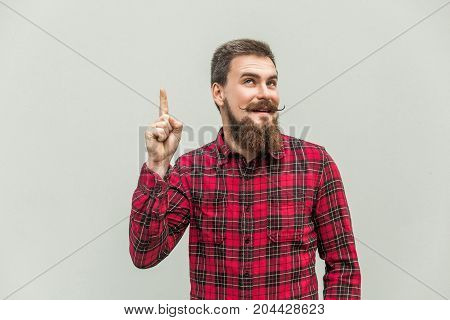 I Have Idea! Handsome Businessman With Beard And Handlebar Mustache Looking At Camera With Finger Up
