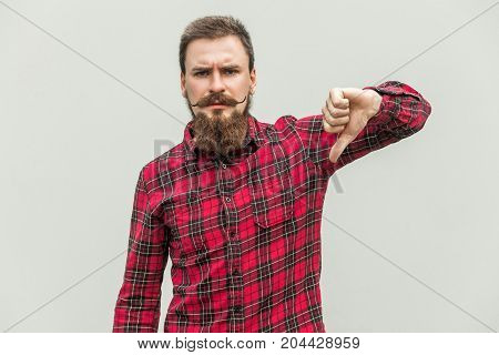 Handsome Bearded Man Showing Thumbs Down Sign To Dislike