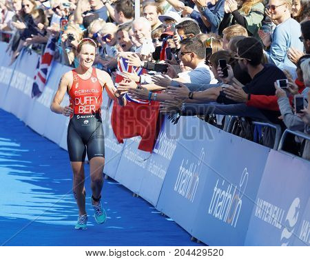 STOCKHOLM - AUG 26 2017: Smiling triathlete Flora Duffy high five the audience in the Women's ITU World Triathlon series event August 26 2017 in Stockholm Sweden