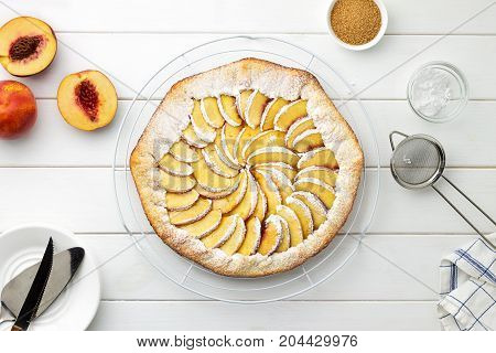 Step By Step Recipe Galette With Nectarines. Fresh Baked Open Pie With Nectarines On Wire Stand On W