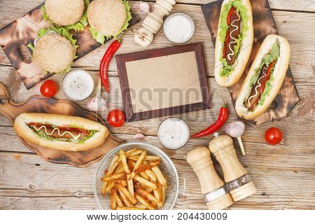 Dining Table On The Hot Dog Day With Copy Space. Fast Food, Hotdogs, Chips, French Fries, Craft Beer
