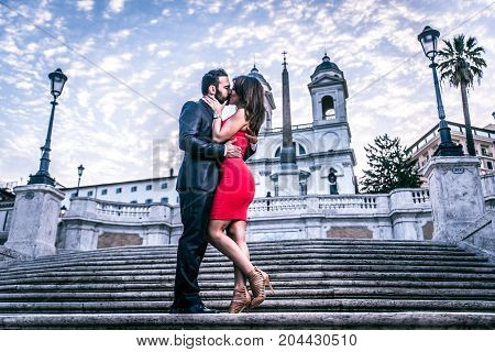 Beautiful couple dating in Rome Italy - Boyfriend and girlfriend kissing outdoors at Spagna Square and Trinita' dei Monti