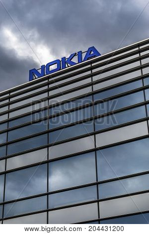 HELSINKI FINLAND - SEPTEMBER 16 2017: Dark clouds over Nokia brand name on top of a building in Helsinki Finland on September 16 2017