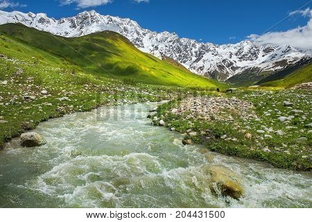 rough mountain stream in the mountains of Upper Svaneti, Greater Caucasus Mountain Range in Georgia