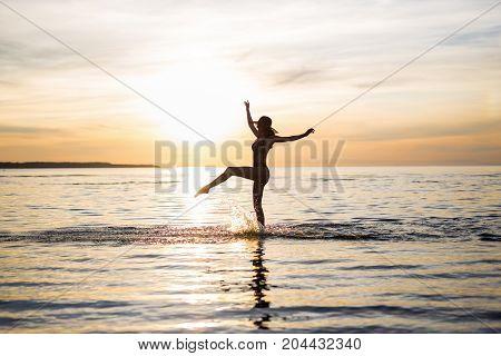 Silhouette Of Slim Sexy Girl In Bikini Walking On The Beach