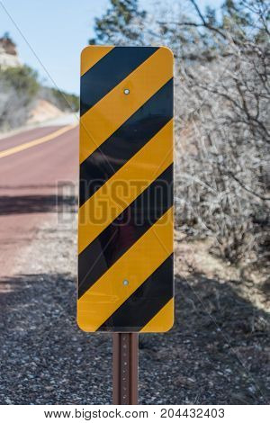 Caution Sign on Side of Road in desert