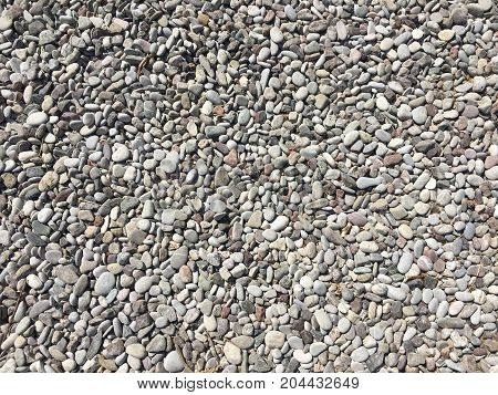 Gray pebbles stone texture and background. Abstract smooth round pebbles sea texture background