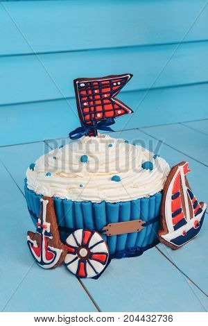 cake sea theme. birthday. to smash the cake for boy. biscuit ship, anchor