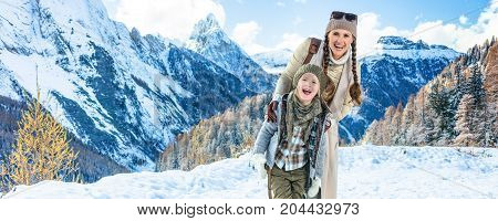 Mother And Daughter Travellers In Front Of Mountain Scenery