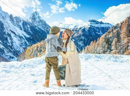 Mother And Daughter Travellers In Winter Outdoors Playing