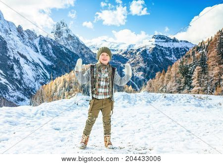 Smiling Modern Girl In South Tyrol, Italy Showing Mittens