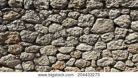 Stone wall texture. Rock wall background. Stone seamless wall