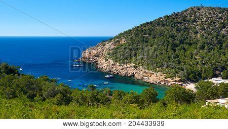 Rocky coastline of Benirras in Ibiza Island. Balearic Islands. Spain