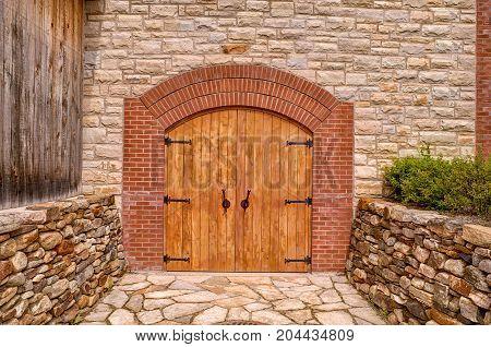 Front door of a rustic wine cellar. Summer day.
