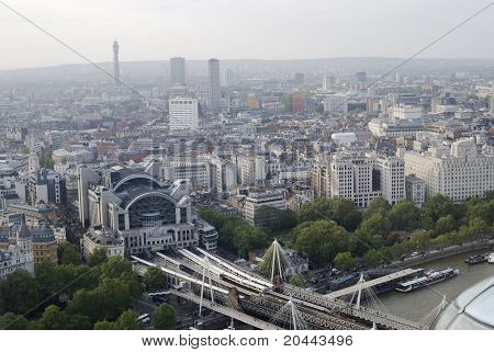 View  over Charing Cross Railway Station and Hungerford Bridge towards West End. Westminster. London. England. Hazy weather poster