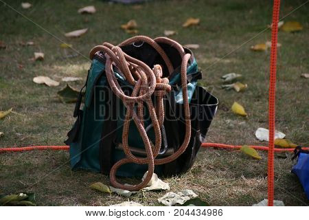Rock climber wearing safety harness and climbing equipment outdoor, close-up image