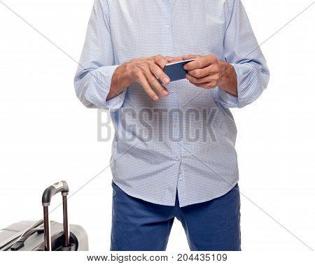 Smiling man checking his passport before trip. part of man