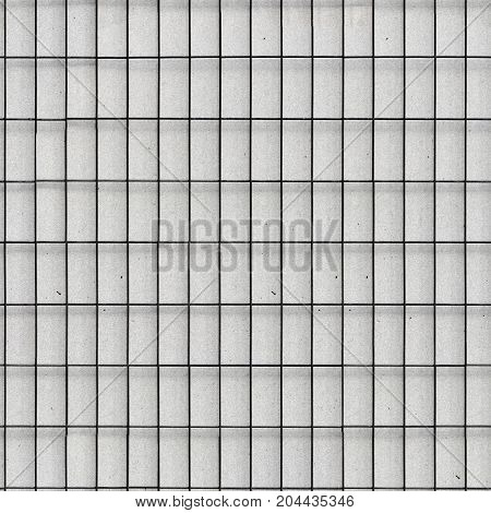 Abstract gray tile wall pattern background or texture. tiling, seamless