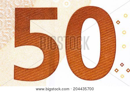 Photographed number in fifty banknote euro. High resolution photo.