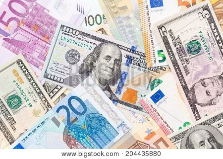 Background made of euros and dollars.  High resolution photo.