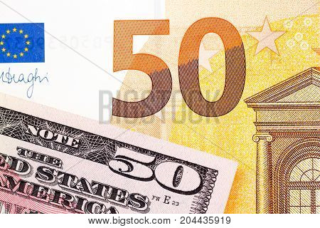 Fifty dollar USA and fifty euro background. High resolution photo.
