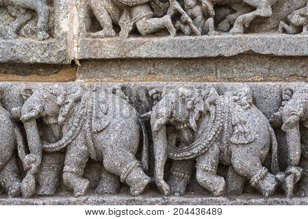 Mysore India - October 27 2013: Close up of frieze on outside wall of central shrine called Trikuta at Chennakesave temple in somanathpur. Line of elephants.