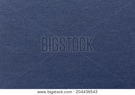 Photograph of navy blue striped pastel paper, coarse grain grunge texture sample. High quality texture in extremely high resolution