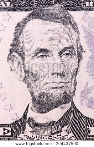 Portrait of Abraham Lincoln on five U.S. dollar bill. High resolution photo.