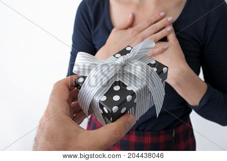 Mans Hand Giving A Female Present Box