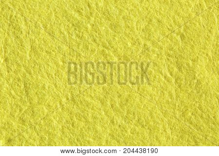 A close up of Yellow felt material texture. High resolution photo.