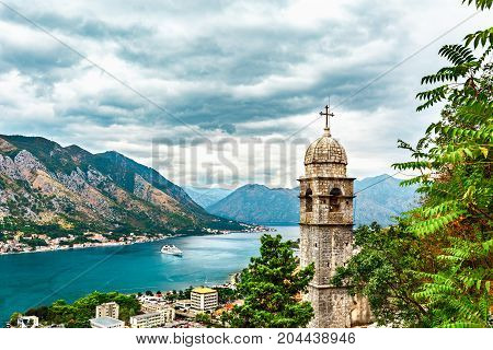 View of Kotor city, Church of Our Lady of Remedy, mediterranean sea, coastal town and mountain landscape in Bay of Kotor, Montenegro.