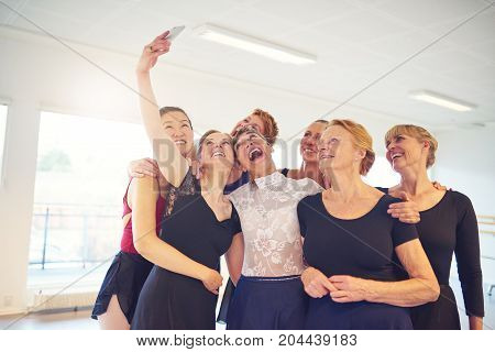 Group Of Laughing Women Taking Selfies In A Dance Studio