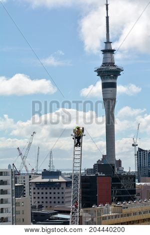 Firefighter On A High Hydraulic Crane Platform